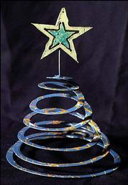 Twenty-five of these spiral star tree-toppers made by Celestial Iron Works, 619 N. Second St., will be sold for $25 at the Festival of Trees auction. The annual event, which benefits The Shelter Inc., is set for 8 p.m. Tuesday.