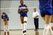 KU volleyball coach Ray Bechard, right, directs the Jayhawk volleyball squad, including Renita Davidson, center, and Jamie Mathewson, during practice. KU worked out Tuesday at Horejsi Center before leaving for Malibu, Calif., where the Jayhawks will play Long Beach State Thursday in the NCAA Tournament.