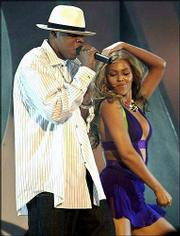 "Jay-Z, left, and Beyonce perform ""Crazy in Love"" during the BET Awards on June 24 in Los Angeles. Rap and R&B dominated the charts this year, and Grammy voters took note, nominating Beyonce, Jay-Z, OutKast and Pharrell Williams for a leading six Grammy nominations each."