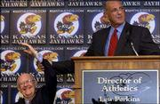 Kansas Athletic Director Lew Perkins hoists Chancellor Robert Hemenway's arm in this file photo during a news conference in which Perkins was introduced as KU's new athletic director. The arm-hoisting was in response to a question about the major reasons Perkins took the job. Perkins was named KU's athletic director in June.