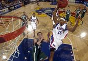 Kansas' J.R. Giddens dunks over Michigan State's Jason Andreas at Allen Fieldhouse.