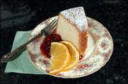 Holiday Orange Cream Cheese Cake With Cranberry-Cherry Sauce is Marilyn Pollack Naron's favorite holiday recipe. The sauce, which contains fresh cranberries, sour cherries and orange zest, adds a festive color to the dessert.