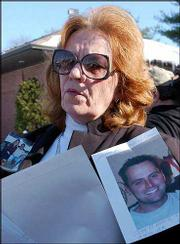 Mary Morin, of Thompson, Conn., shows photos of her son, Ryan, who was killed in the Feb. 20 nightclub fire in Warwick, R.I. Morin met Tuesday with Atty. Gen. Patrick Lynch, who told victims' family members of the first criminal charges filed in the fire.