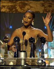 Beyonce Knowles accepts her award for new female artist of the year. She also was awarded new R&B artist, Hot 100 female artist and a special Hot 100 award at Wednesday's ceremony.