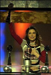 Shania Twain accepts her award for country performer of the year during the Billboard Music Awards at the MGM Grand Garden Arena in Las Vegas.
