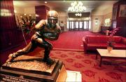 The Heisman trophy sits in the lobby of the Downtown Athletic Club in New York in this file photo. The finalists for this year's award are: Larry Fitzgerald, Pittsburgh; Jason White, Oklahoma; Eli Manning, Mississippi; and Chris Perry, Michigan.