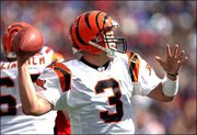 Cincinnati quarterback Jon Kitna unleashes a pass in this Oct. 5 file photo. Kitna has the Bengals in playoff contention, winning accolades along the way.