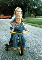 Brandt Fewins, 3, gives his sister, Chloe Jo Fewins, 5, a ride on his tricycle. They are the children of Carrie and Scott Fewins and the grandchildren of Kathleen and Bill Argersinger, who submitted the picture. All are of Lawrence.
