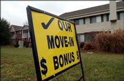 Apartments in Lawrence are offering move-in specials and other deals to attract tenants. A sign advertising deals at Graystone Apartments, 2512 W. Sixth St., was posted last week.