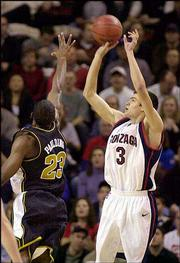 Gonzaga's Adam Morrison (3) shoots over Missouri's Rickey Paulding. The 17th-ranked Bulldogs knocked off No. 3 Missouri, 87-80 in overtime, Saturday in Seattle.
