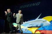 Kansas University and Lawrence High School alumnus Alan Mulally, CEO of Boeing Commercial Airplanes, left, applauds as Boeing CEO Harry Stonecipher pumps his fist. Stonecipher announced Tuesday that Boeing would build the new fuel-efficient 7E7 Dreamliner passenger plane in Everett, Wash.