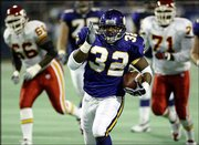 Minnesota's Onterrio Smith (32) runs away from Kansas City's Jimmy Wilkerson (66) and Eddie Freeman (71) for 47 of his 146 yards in the Vikings' 45-20 victory over the Chiefs. The Vikes won Saturday in Minneapolis.