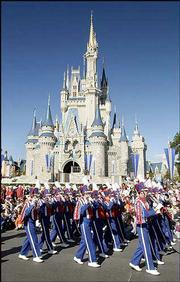 The Kansas University Marching Band parades in Mickey's Very Merry Christmas Parade Sunday at Disney World.