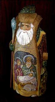This carved Russian Santa's open robe displays a detailed Nativity painting of Mary, Joseph and the baby Jesus.