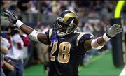 St. Louis running back Marshall Faulk celebrates his second touchdown of the game against Cincinnati. The Rams beat the Bengals, 27-10, Sunday in St. Louis.
