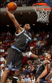 Orlando's Tracy McGrady puts down a one-handed dunk for two of his 41 points. The Magic edged Cleveland, 113-101 in overtime, Thursday in Orlando, Fla.
