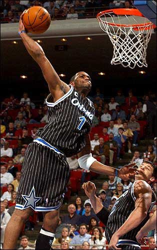 Orlando s Tracy McGrady puts down a one-handed dunk for two of his41    Tracy Mcgrady Dunk