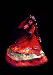 Iran's best-known female dancer, Farzaneh Kaboli, performs rhythmic movements during a drama festival in this photo taken in February 2003, in Tehran, Iran. Kaboli and 24 of her students were detained Wednesday on charges of dancing in public.