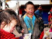 Two children whose eyes were harmed by toxic fumes from the fatal gas blowout at a natural gas field belonging to the China National Petroleum Corporation are seen in Chongqing in Kaixian County, some 337 km. northeast of Chongqing Municipality. Tuesday's blowout claimed the lives of at least 191 people.
