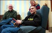 Jon Ruhlen visits with his parents, David and Betty Ruhlen, of Lawrence. Friday, the Emporia State University English student packed up his belongings to join his unit at Fort Riley, where he will train for February duty in Iraq.