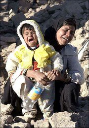 A mourning Iranian mother and her child cry for their families who were killed in a destructive earthquake in Bam, Iran. The devastating 6.5-magnitude quake struck at 5:28 a.m. Friday, an hour that found almost all of the city's 80,000 residents in their beds on the Muslim day of rest.
