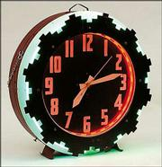 This Aztec neon clock was made in 1936. The colorful clock, 26