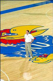 Kansas basketball coach Bill Self watches players work out during the preseason. Self replaced coach Roy Williams in April. KU's athletic department experienced a major overhaul in 2003 after AD Al Bohl was fired and replaced by Lew Perkins.