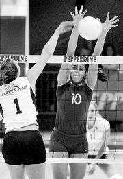 KU volleyball player Josi Lima blocks a shot against Pepperdine during the NCAA Tournament.