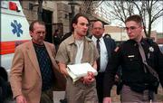 John Lotter, center, is escorted from the Richardson County Courthouse in Falls City, Neb., in this Feb. 21, 1996, file photo, after being sentenced to death for the December 1993 murders of Brandon Teena, Philip DeVine and Lisa Lambert.
