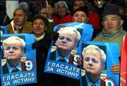 Socialist Party of Serbia supporters show pictures of former Yugoslav President Slobodan Milosevic, during last week's final pre-election rally in Belgrade, Serbia-Montenegro.