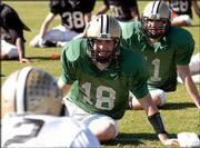 Purdue quarterback Kyle Orton laughs while stretching during practice. The Boilermakers worked out Saturday in Orlando, Fla., in preparation for their New Year's Day date with Georgia in the Capital One Bowl.