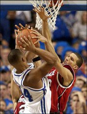 Louisville's Francisco Garcia, right, blocks a shot by Kentucky's Chuck Hayes. Louisville defeated Kentucky, 65-56, Saturday in Lexington, Ky.