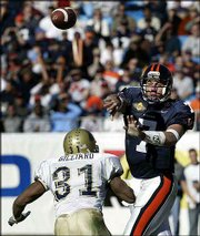 Virginia's Matt Schaub (7) throws a pass over Pittsburgh's Tyrone Gilliard (31). Schaub was the MVP of the Continental Tire Bowl Saturday at Charlotte, N.C.