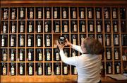 Melynda Simonsen stores tea at Pekoe Sip House in Boulder, Colo. Pekoe Sip House carries 100 different types of tea.