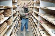 Olathe writer Laird Wilcox looks through his personal collection of political papers and paraphernalia at Kansas University's Spencer Research Library. Wilcox has been writing about and collecting materials on political extremists since the 1960s.
