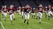 Oklahoma players, including Blake Ferguson (87), Renaldo Works (47) and Donta Hickson (35) run during practice. The Sooners tried out the Superdome's new AstroPlay turf during Monday's practice at New Orleans.