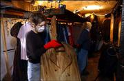 Lauren Kimball, Lawrence, left, and Sarah Young remove damaged costumes from the storage room at the Lawrence Community Theatre, 1501 N.H. A fire broke out Monday evening in the building's basement, causing $15,000 in damage, mostly in the area of the costume room.