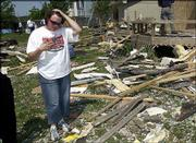 Ann Riat's home is showered with debris from the Aberdeen South apartments, which were the first buildings hit by the May 8 tornado in Lawrence. Riat's home had to be razed and rebuilt as a result of the damage from the F2 tornado that hit southwest Lawrence.