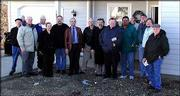Habitat for Humanity church liaisons and their pastors gathered Dec. 20 for the dedication of a house near 17th and Harper streets sponsored by the churches. From left are Kent Tomlinson, the Rev. Lew Hinshaw, John Harris, the Rev. Amanda Larsen, the Rev. Randy Beeman, the Rev. Don Miller, Delmer Kruse, the Rev. Gary Teske, the Rev. Jim Shaughnessy, Steve Ramirez, Steve Hillmer, the Rev. Jeff Lilley and Dick Stumbo. The house is Habitat for Humanity's 53rd in Lawrence. Twelve Lawrence churches were involved in the project.