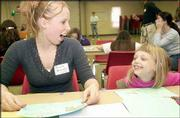 Tricia Dunham chats with Lindsey Griffin, 7, during the goal-setting session of the Douglas County Girl Scout Cookie Kick-Off.