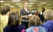 Girl Scout Tricia Dunham, a sophomore at Free State High School, instructs a group of younger Girl Scouts during the Douglas County Girl Scout Cookie Kick-Off on Saturday at the Douglas County 4-H Fairgrounds. Dunham says she has made lifelong friends by staying involved in Girl Scouts.