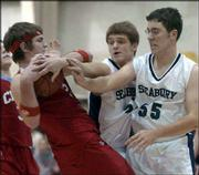 Seabury's Grayson Dillon, center, and Blake Phipps harass a Colony-Crest player in the Seahawks' 39-29 loss. Seabury remained winless Tuesday at the Seabury gym.