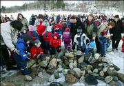 More than 300 schoolchildren and adults bid farewell to Keiko, the killer whale Thursday by building a burial mound of stone over the Hollywood star's grave. Keiko died Dec. 12, probably from pneumonia, in Taknes Bay in Halsa township, Norway.