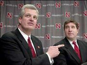 Nebraska athletic director Steve Pederson, left, introduces Bill Callahan as the Huskers' new football coach. Callahan appeared Friday in Lincoln, Neb.