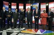 Democratic presidential hopefuls, from left, Dick Gephardt, Al Sharpton, Dennis Kucinich, Joe Lieberman, John Edwards, John Kerry, Carol Moseley Braun and Howard Dean line up before the start of the Brown and Black Forum in Des Moines, Iowa. Dean came under fire during Sunday's debate for not hiring minorities to his Cabinet during his tenure as Vermont governor.