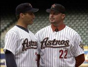 Newly acquired Houston pitchers Roger Clemens, right, and Andy Pettitte chat after Clemens announced his signing with the Astros at a news conference.