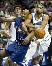 Philadelphia's Zendon Hamilton (42) fights for a rebound with Orlando's Drew Gooden, a Kansas University product, during the first quarter. Gooden had two points in an 87-82 defeat Monday in Orlando, Fla.