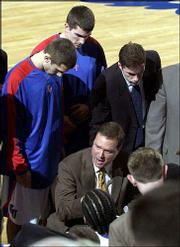 Kansas coach Bill Self draws up a play during a timeout against Kansas State.
