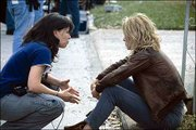 "Filmmaker Patty Jenkins, left, a Lawrence native, directs star Charlize Theron on the set of ""Monster."" The drama tells the story of executed murderer Aileen Wuornos, who is regarded as ""America&squot;s first female serial killer."" The film is expected to earn Theron an Academy Award nomination for Best Actress."