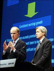 William B. Harrison Jr., left, CEO of J.P Morgan Chase, and Bank One CEO James Dimon address an analysts meeting in New York. The executives talked Thursday about their $58 billion merger.